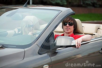 Young couple in a convertible car