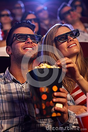 Young couple in 3D movie