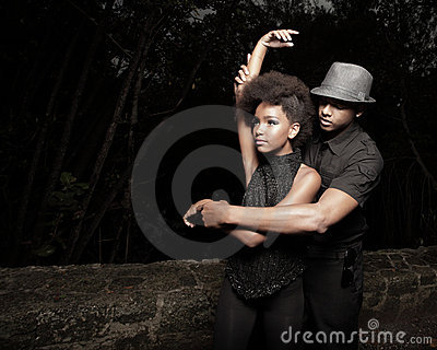 Young couple dancing in the dark