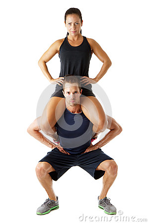 Young couple doing fitness exercise