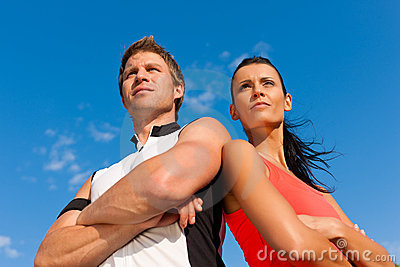 Young couple is doing sports outdoors