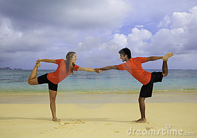 Young couple doing yoga, exercise