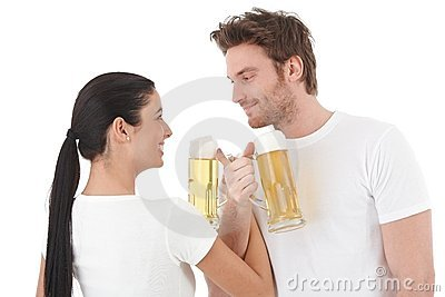 Young couple drinking beer smiling Stock Photo