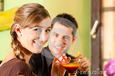 Young couple drinking cocktails