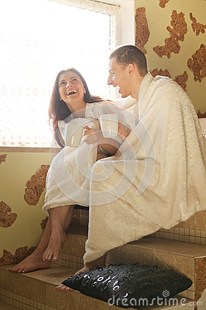 Young couple drinking coffee and laughs