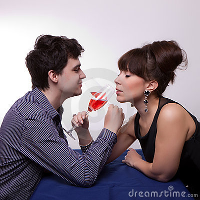 Young couple drinking rose wine