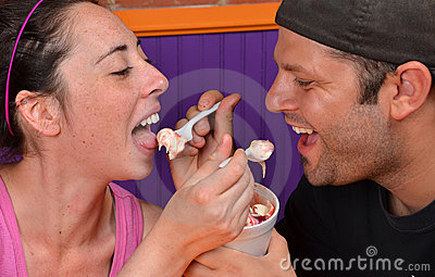 Young Couple Eating Frozen Yogurt Together