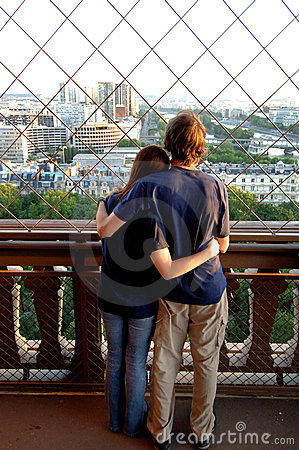 Young couple on Eiffel tower