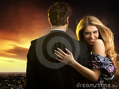 young couple in elegant evening dresses