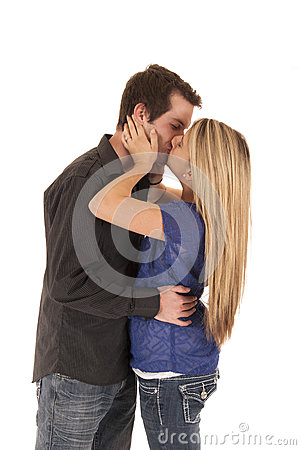 Young couple embracing in a kiss standing up