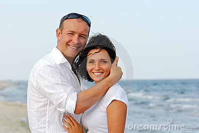 Young couple embracing by sea