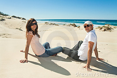Young couple enjoy beautiful day on the beach