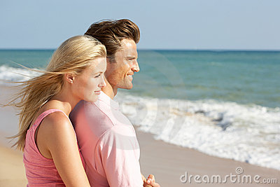 Young Couple Enjoying Beach Holiday In The Sun