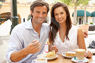 Young Couple Enjoying Coffee And Cake