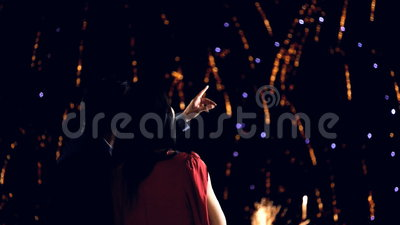 Young couple enjoying new year's eve fireworks. Rear view stock video