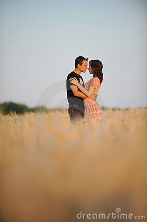 Young couple in the field