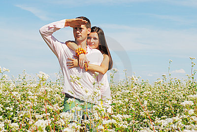 Young couple on field of flowers