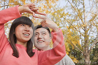Young couple framing with fingers