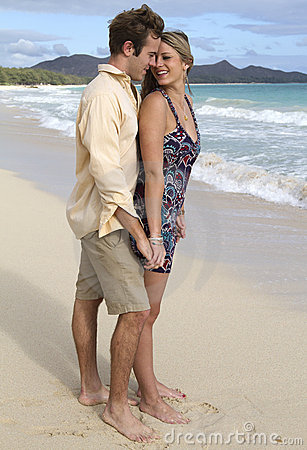 Young couple get romantic on the beach