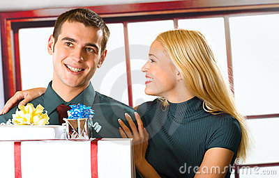 Young couple with gift boxes