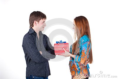Young couple with a gift isolated