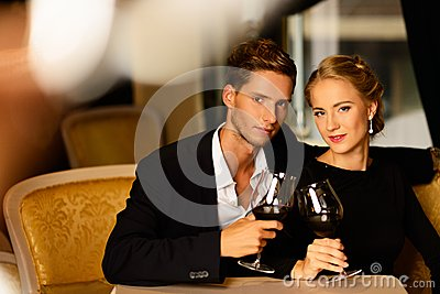 Young couple with glasses of wine