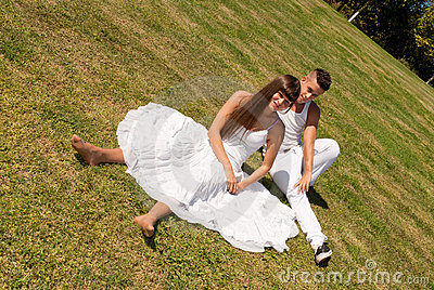 Young couple on grass white love relationship