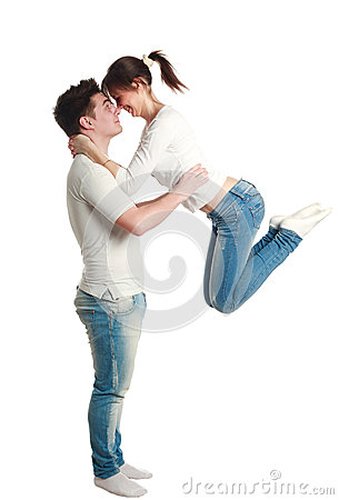 Young couple, guy with jumping up girl, studio, isolated