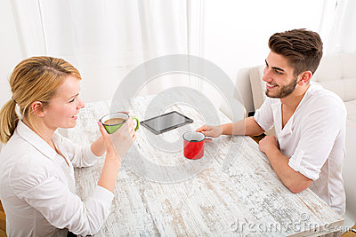 Young couple having a coffee break