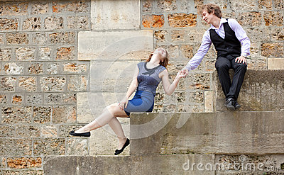 Young couple having fun at the embankment