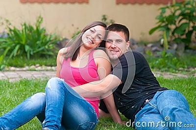 Young couple having fun in the garden
