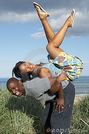 Young Couple Having Fun In Sand Dunes