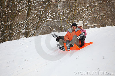 Young couple having fun in snow