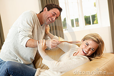 Young couple having fun on sofa