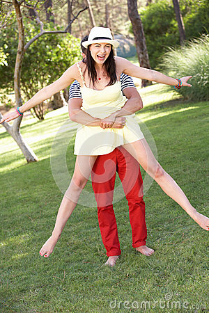 Young Couple Having Fun Together In Garden