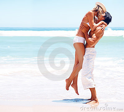 Young couple having a good time on a beach