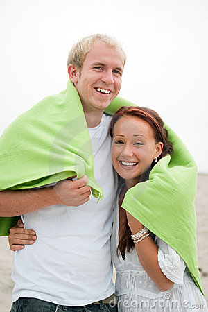 Young couple having romantic fun on the beach