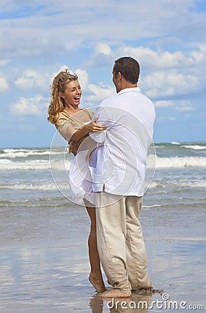 Young Couple Having Romantic Fun On A Beach