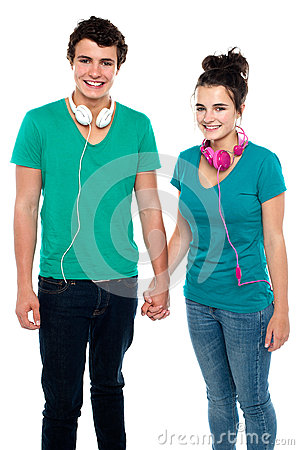Young couple with headphones around their necks