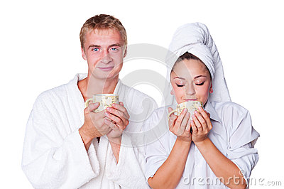 Young couple holding cup of tea