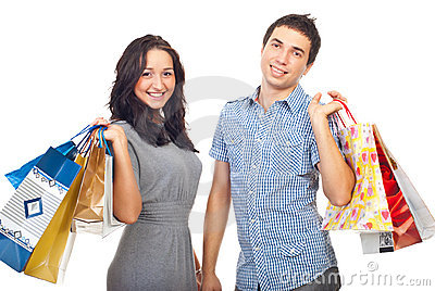 Young couple holding shopping bags