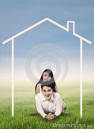 Young couple with house drawing
