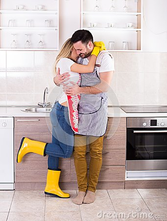 Free Young Couple Hugging After Housework Stock Photography - 110707332