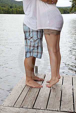 Young Couple Hugging on Dock
