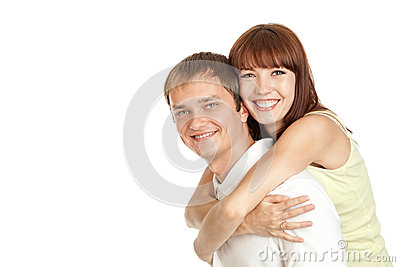 Young couple hugging each other.