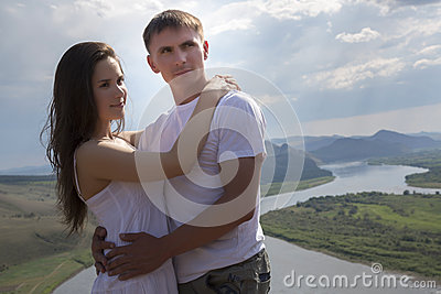 Young Couple hugging in mountains