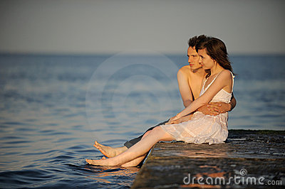 Young couple hugging on a pier