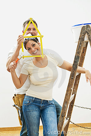 Young couple improving home