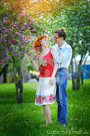 Free Young Couple In Love Walking At The Blossoming Spring Garden Royalty Free Stock Photo - 54366375