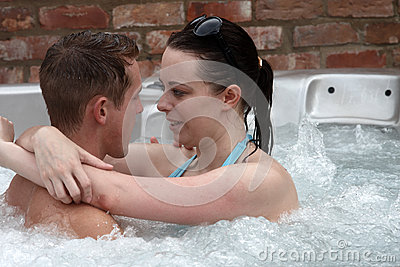 A young couple in the jacuzzi